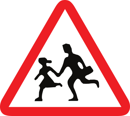 Señal vertical de advertencia de peligro por la proximidad de un lugar frecuentado por niños